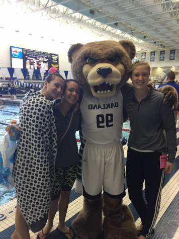 Sophomore Sam Villiani poses for a picture with the Oakland University mascot and fellow swimmers Hannah Mattes and Angelina Cavaliere.